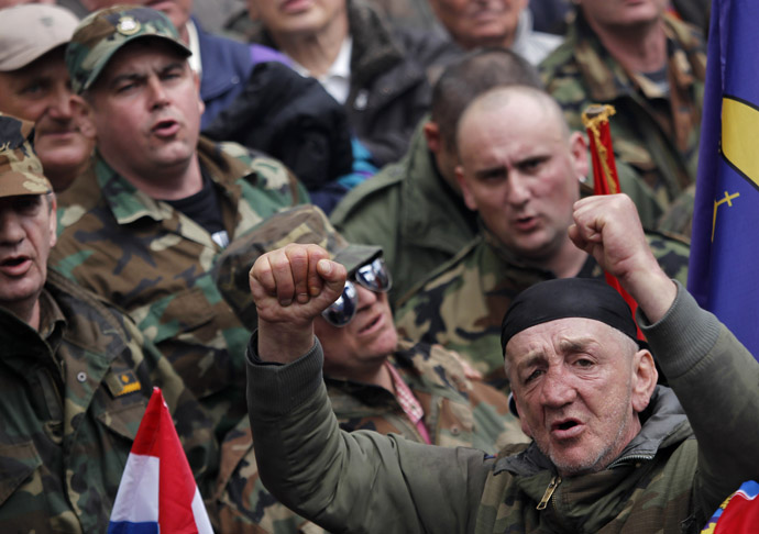 Croatian war veterans sing songs during a protest against Cyrillic signs at Zagreb's main square April 7, 2013. (Reuters/Antonio Bronic)
