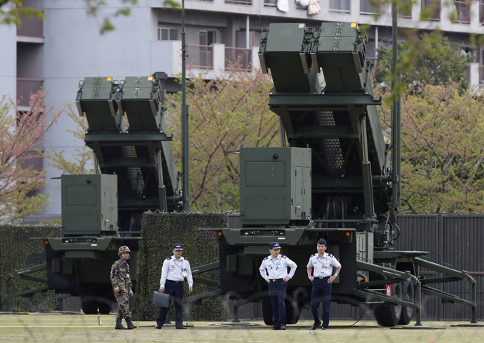 Japan Self-Defence Forces soldiers walk near Patriot Advanced Capability-3 (PAC-3) missiles at the Defence Ministry in Tokyo April 9, 2013. (Reuters)
