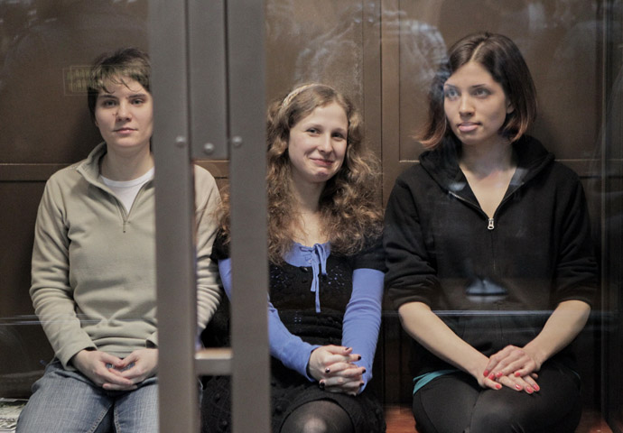 From left: Pussy Riot punk band members Yekaterina Samutsevich, Mariya Alyokhina and Nadezhda Tolokonnikova, convicted of hooliganism in Christ the Savior Cathedral and sentenced to two years' imprisonment, are present at their appeal hearing in the Moscow City Court. (RIA Novosti/Andrey Stenin)