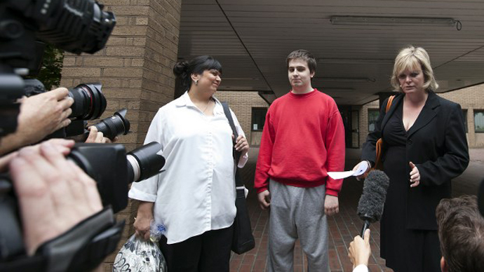 This file photo shows Ryan Cleary, a British teenager charged with attacking websites as part of the international hacking group Lulz Security, flanked by his mother Rita Cleary (L) and solicitor Karen Todner (R), leaves a London court. (AFP Photo / Warren Allott)