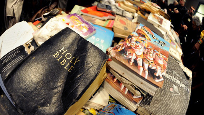 A bible and other recovered books from the Occupy Wall Street library damaged in the November 15 eviction of Zuccotti Park on display at a press conference November 23, 2011 at a lawyers office in New York. (AFP Photo / Stan Honda)