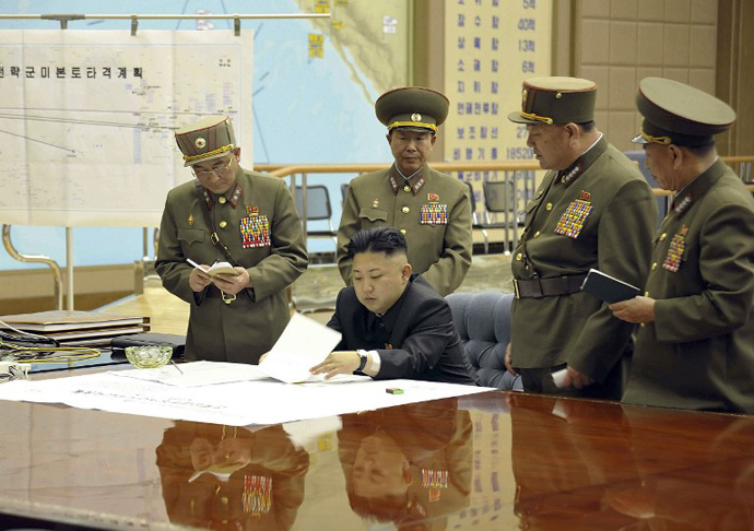 This file photo taken and released by North Korea's official Korean Central News Agency (KCNA) shows, according to KCNA, North Korean leader Kim Jong-Un discussing the strike plan with North Korean officers. (AFP Photo / KCNA)