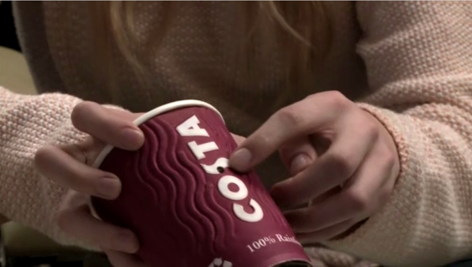 Olivia shows RT a minute camera concealed inside a takeaway coffee cup