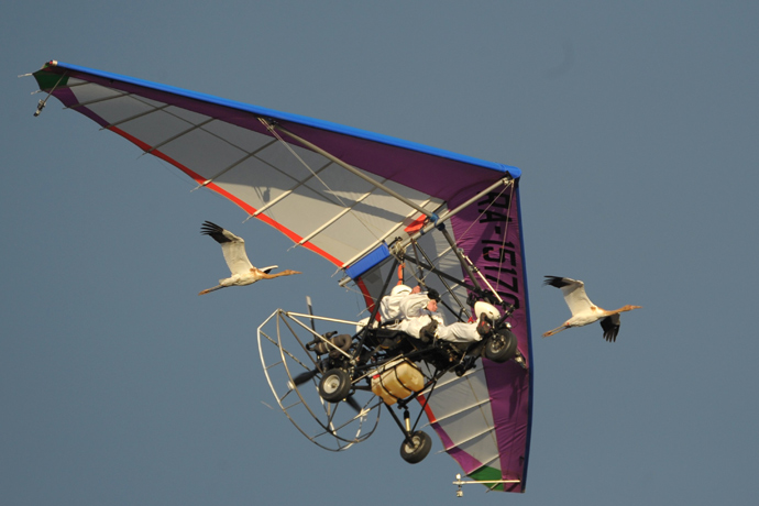 In the sky: a motorized hang glider with Russian President Vladimir Putin at the controls (RIA Novosti / Alexsey Druginyn)