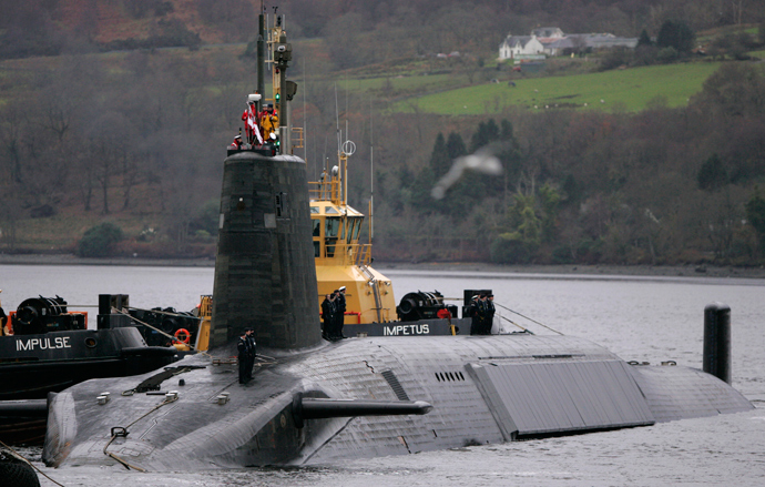 Crew from HMS Vengeance, a British Royal Navy Vanguard class Trident Ballistic Missile Submarine, stand on their vessel as they return along the Clyde river to the Faslane naval base near Glasgow, Scotland (Reuters / David Moir)
