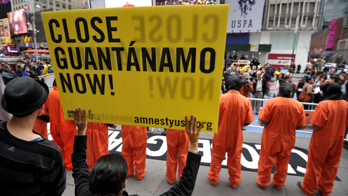 Activists demand the closing of the US military's detention facility in Guantanamo during a protest, part of the Nationwide for Guantanamo Day of Action, April 11, 2013 .(AFP Photo / Stan Honda)