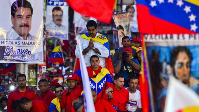 Venezuelan acting President and presidential candidate Nicolas Maduro gestures during his closing campaign rally in Caracas on April 11, 2013.(AFP Photo / Luis Acosta)