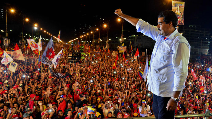 Venezuelan acting President and presidential candidate Nicolas Maduro gestures during his closing campaign rally in Caracas on April 11, 2013 .(AFP Photo / Luis Acosta)