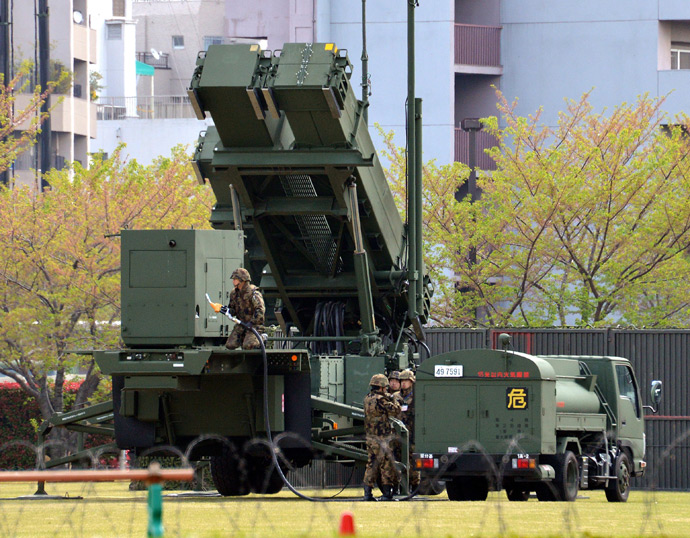A Patriot Advanced Capability-3 (PAC-3) missile launcher is refueled from a tank truck at the Defence Ministry in Tokyo on April 11, 2013 (AFP Photo / Yoshikazu Tsuno)