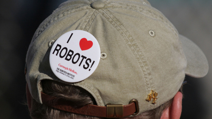 A robotics fan wears a button on his hat at the Defense Advanced Research Projects Agency (DARPA) Grand Challenge in Primm Nevada. (Reuters / Gene Blevins)