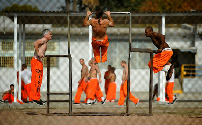 Inmates at Chino State Prison exercise in the yard in Chino, California. (AFP Photo / Kevork Djansezian)