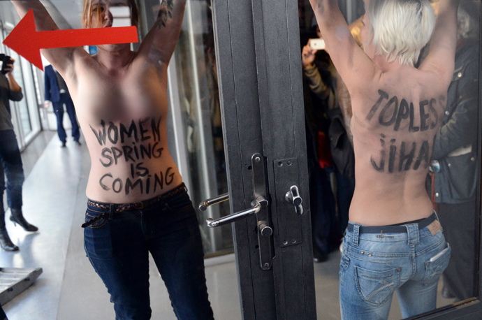 Femen militants protest during a press conference by Tunisian President Moncef Marzouki (unseen) in Paris on April 12, 2013 (AFP Photo / Eric Feferberg)