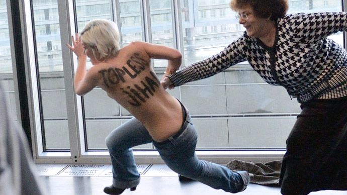 Femen crucifies, burns Barbie doll to protest Berlin's 'Dreamhouse' opening (PHOTOS)