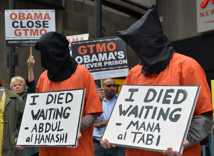 People dress in orange jumpsuits and black hoods as activists demand the closing of the US military's detention facility in Guantanamo during a protest, part of the Nationwide for Guantanamo Day of Action, April 11, 2013 in New York's Times Square. (AFP Photo/Stan Honda)