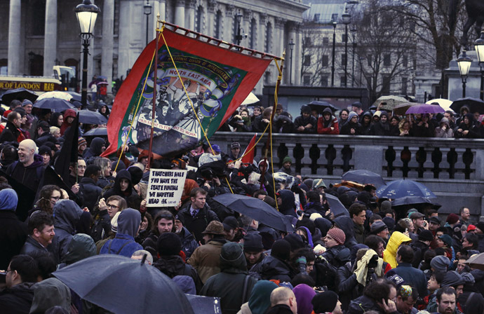A banner representing the National Union of Mineworkers is carried through the crowd at a party to celebrate the death of the late former British prime minister Margaret Thatcher in central London April 13, 2013. (Reuters)