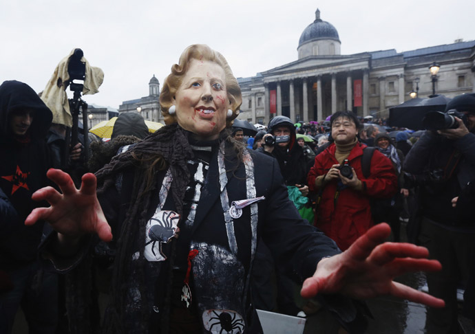 A woman wearing a mask representing late former British prime minister Margaret Thatcher poses for photographers at a party to celebrate Thatcher's death at Trafalgar Square in central London April 13, 2013. (Reuters)