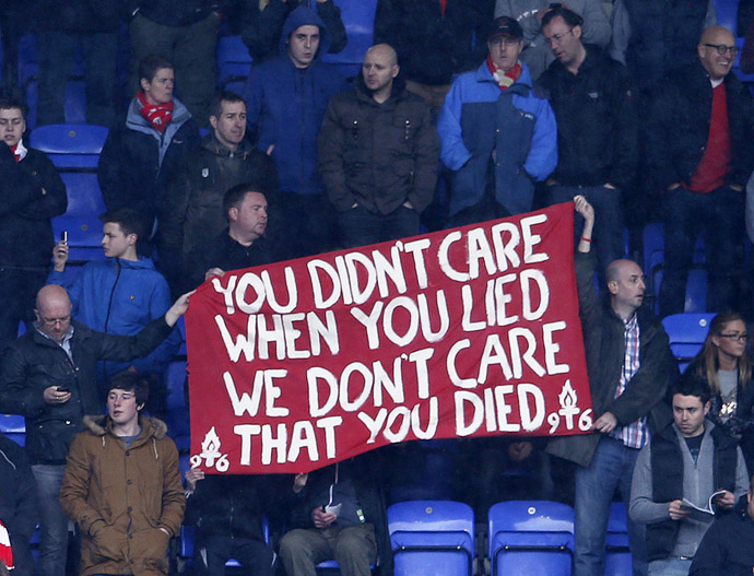 Liverpool fans hold up a banner commenting on the death of former British Prime Minister Margaret Thatcher, before their English Premier League soccer match against Reading at the Madejski Stadium in Reading, April 13, 2013. (Reuters)