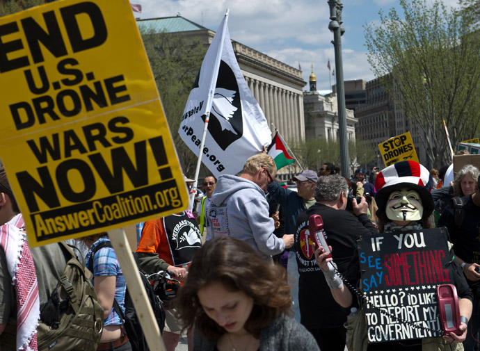 Protesters hold signs and chant slogans outside the White House in Washington on April 13, 2013 during a demonstration against the use of dones against Islamic militants and other perceived enemies of the US around the world. (AFP Photo/Nicholas Kamm)