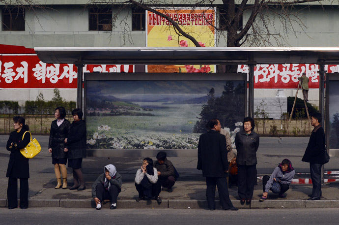 North Koreans wait for a bus in Pyongyang on April 11, 2012. (AFP Photo/Pedro Ugarte)
