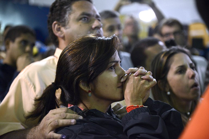 Supporters of Venezuelan presidential candidate Henrique Capriles react showing their dissapointment in Caracas on April 14, 2013. (AFP Photo / Leo Ramirez)
