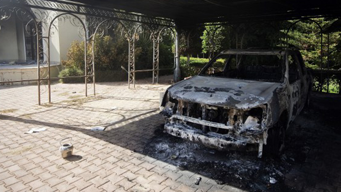 A picture shows a burnt vehicle inside the US consulate compound in Benghazi on September 13, 2012. (AFP Photo / Gianluigi Guercia)