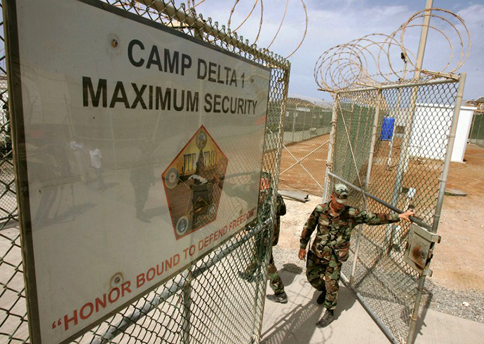 A US Army guard opens the gate at Camp Delta at Guantanamo Naval Base 23 August, 2004 in Guantanamo, Cuba. (AFP Photo / Mark Wilson)
