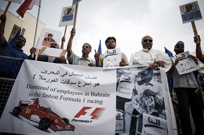Bahraini protesters hold up a placards during a demonstration in the capital Manama, on April 13, 2013. (AFP Photo / Mohammed Al-Shaikh)