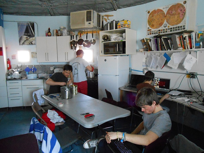 The MDRS crew 127 working inside the station (Image from Flickr user MDRS.Photos)