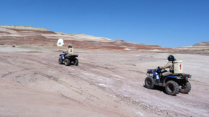 The MDRS crew driving ATVs during a surface mission (Image from Flickr user MDRS.Photos)