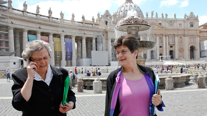 Sister Pat Farrell (R), president of the Leadership Conference of Women Religious (LCWR), and Sister Janet Mock, the executive-director, walk in Saint Peter's Square at the Vatican (Reuters / Max Rossi)