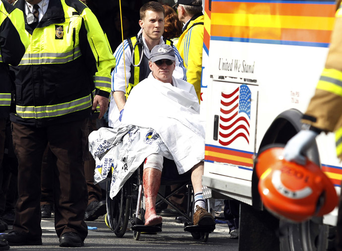 A runner in a wheelchair is taken from a triage tent after explosions went off at the 117th Boston Marathon in Boston, Massachusetts April 15, 2013 (Reuters / Jessica Rinaldi)