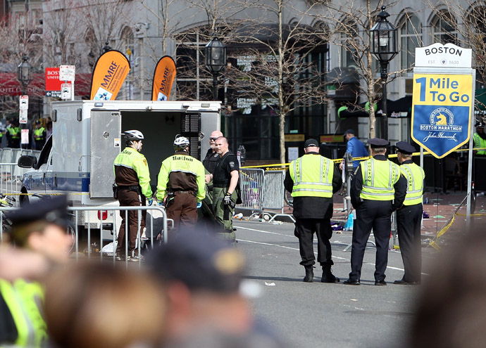 Police guard an area at the one mile checkpoint near Kenmore Square after two bombs exploded during the 117th Boston Marathon on April 15, 2013 in Boston, Massachusetts (Alex Trautwig / Getty Images / AFP)