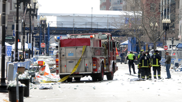 Firefighters take postion on Boyltson Street near the finish line after two bombs exploded during the 117th Boston Marathon on April 15, 2013 in Boston, Massachusetts (AFP Photo / Darren McCollester)