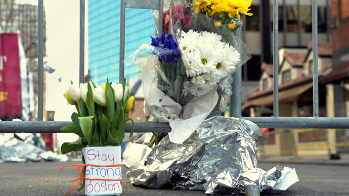 Flowers and a message are left on Newbury Street April 16, 2013 in Boston.(AFP Photo / Stan Honda)