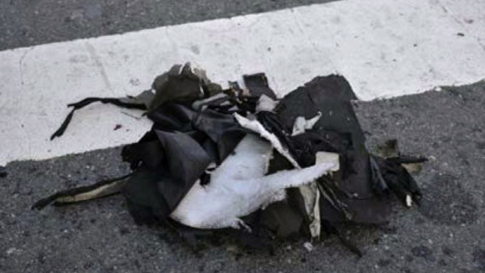 This photograph obtained April 16, 2013 courtesy of the Federal Bureau of Investigation (FBI) shows the remnants of a black backpack that the FBI says contained one of the bombs used in the Boston Marathon on April 15, 2013.(AFP Photo / FBI)