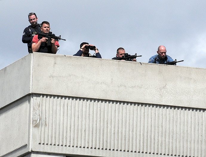 Snipers take positions on a rooftop during the manhunt in Watertown, Massachusetts, for the second suspect in the Boston Marathon bombing who is still at large on April 19, 2013. (AFP Photo/John Mottern)