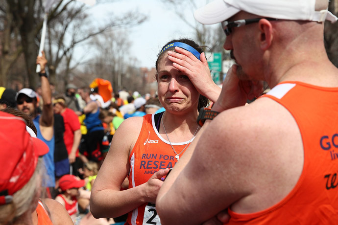 A runner reacts near Kenmore Square after two bombs exploded during the 117th Boston Marathon on April 15, 2013 in Boston, Massachusetts (Alex Trautwig / Getty Images / AFP)