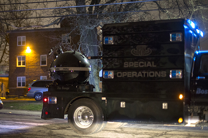 A law enforcement vehicle carries a bomb disposal device through Watertown during a search for the two men suspected of setting off two explosions during the Boston Marathon in Watertown, Massachusetts, April 19, 2013. (Reuters / Lucas Jackson)