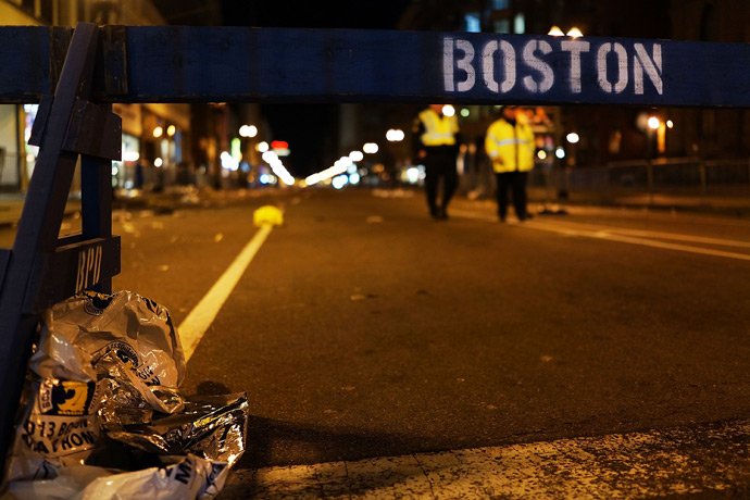 A piece of debris rests against a police barricade near the scene of a twin bombing at the Boston Marathon, on April 16, 2013 in Boston, Massachusetts (Reuters / Spencer Platt)