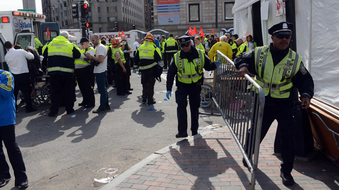 Emergency personnel take postion at the finish line after two bombs exploded during the 117th Boston Marathon in Boston, Massachusetts (AFP Photo / Darren McCollester)