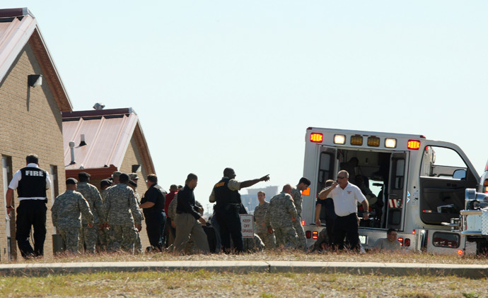 First responders prepare the wounded for transport in waiting ambulances outside Fort Hood's Soldier Readiness Processing Center, after a mass shooting at the military base November 5, 2009 (Reuters)