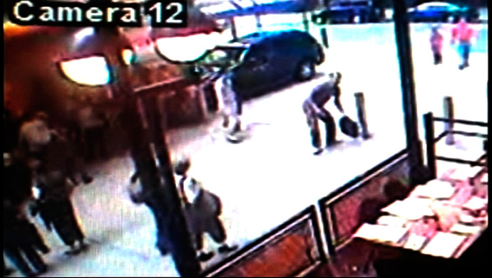 A surveillance photo shows a man with a bag removing a shirt near Times Square where he is suspected of leaving a car bomb set up in a Nissan Pathfinder sports utility vehicle in Times Square in this New York Police Department surveillance footage released to Reuters on May 3, 2010 (Reuters / NYPD)