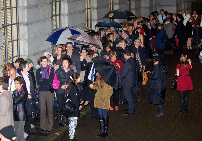 Hundreds of people wait outside the parliament building in Wellington on April 17, 2013 for a place in the public gallery to see the chamber vote on a bill amending the 1955 Marriage Act to describe matrimony as a union of two people regardless of their sex, sexuality or how they choose to identify their gender (AFP Photo / Marty Malville)