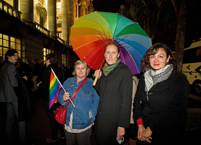 Gay-rights supporters wait outside the parliament building in Wellington on April 17, 2013 for a place in the public gallery to see the chamber vote on a bill amending the 1955 Marriage Act to describe matrimony as a union of two people regardless of their sex, sexuality or how they choose to identify their gender (AFP Photo / Marty Malville)