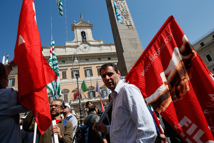 Members of Italy's main trade unions, Italian General Confederation of Labour (CGIL), Italian Confederation of Workers' Trade Unions (CISL) and Italian Labour Union (UIL), demonstrate to draw attention on the worsening conditions of the Italian workforce, in front of the Lower House of Parliament in Rome April 16, 2013 (Reutres / Tony Gentile)