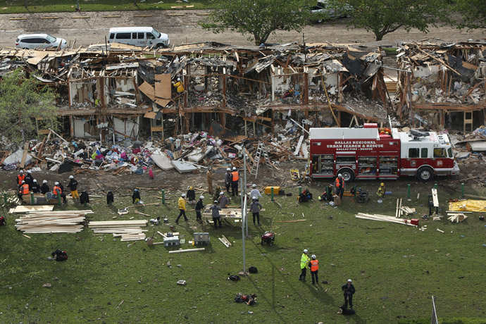 Search and rescue workers comb through what remains of a 50-unit apartment building the day after an explosion at the West Fertilizer Company destroyed the building April 18, 2013 in West, Texas. (Chip Somodevilla/Getty Images/AFP )