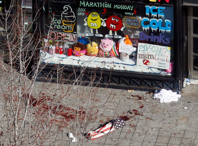 Blood in seen on the sidewalk in front of a candy store advertising a Marathon Monday sale a day after two explosions at the Boston Marathon in Boston, Massachusetts April 16, 2013 (Reuters / Jessica Rinaldi)