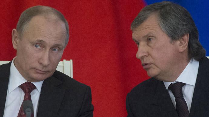 Vladimir Putin (L) and Igor Sechin (RIA Novosti / Sergey Guneev)