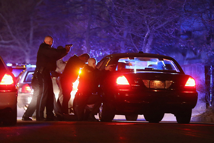 Police with guns drawn search for a suspect on April 19, 2013 in Watertown, Massachusetts. (AFP Photo / Mario Tama)