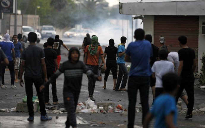 Anti-government protesters stand in front of a teargas cloud fired by riot police during a demonstration in the village of Diraz west of Manama April 18, 2013, ahead of this weekend's Formula One Grand Prix. Bahrain human rights activist Nabeel Rajab (Reuters/Hamad I Mohammed)